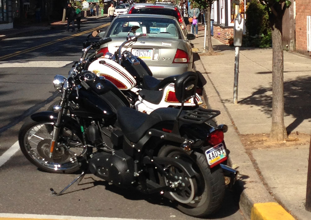 Motorcycle parking on busy street