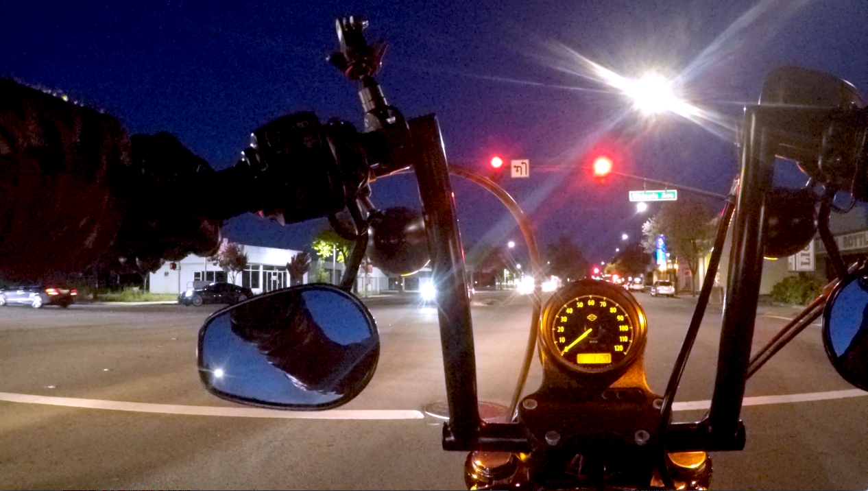 Riding a motorcycle at night street lights